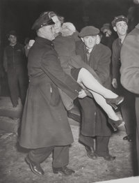 WEEGEE (American, 1899-1968) Untitled (Woman Carried by Policemen), circa 1940 Vintage gelatin silve