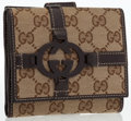 Luxury Accessories:Accessories, Gucci Beige Monogram Canvas & Brown Leather Trifold Wallet. ...