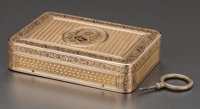 A CONTINENTAL TWO COLOR 18K GOLD MUSIC BOX, circa 1880 Marks: (effaced marks), G 3/4 x 3-1/8 x 2-1/4