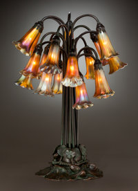 TIFFANY STUDIOS BRONZE AND FAVRILE GLASS EIGHTEEN-LIGHT LILY LAMP Circa 1910. Bas
