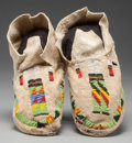 American Indian Art:Beadwork and Quillwork, A PAIR OF CHEYENNE BEADED HIDE MOCCASINS. c. 1920... (Total: 2 Items)