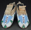 American Indian Art:Beadwork and Quillwork, A PAIR OF UTE BEADED HIDE MOCCASINS. c. 1890... (Total: 2 Items)