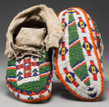 American Indian Art:Beadwork and Quillwork, A PAIR OF SIOUX CEREMONIAL BEADED HIDE MOCCASINS. c. 1920...(Total: 2 Items)