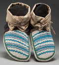 American Indian Art:Beadwork and Quillwork, A PAIR OF PLAINS CREE BEADED HIDE MOCCASINS. c. 1900... (Total: 2Items)