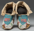 American Indian Art:Beadwork and Quillwork, A PAIR OF SIOUX PICTORIAL BEADED HIDE MOCCASINS. c. 1920... (Total:2 Items)