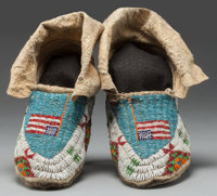 A PAIR OF SIOUX PICTORIAL BEADED HIDE MOCCASINS c. 1920