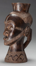 Tribal Art, Kuba (Democratic Republic of Congo). Figural cup . First half 20thcentury. Carved hardwood. Height: 9 inches. Provenance...