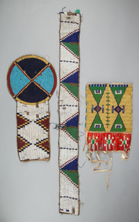 THREE SIOUX BEADED HIDE FRAGMENTS