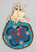 American Indian Art:Beadwork and Quillwork, AN APACHE BEADED HIDE POUCH. ...