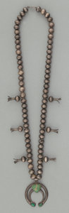 American Indian Art:Jewelry and Silverwork, A NAVAJO SILVER AND TURQUOISE SQUASH BLOSSOM NECKLACE . c. 1940...