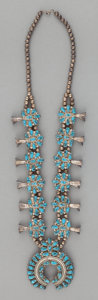American Indian Art:Jewelry and Silverwork, A NAVAJO OR ZUNI SILVER AND TURQUOISE SQUASH BLOSSOM NECKLACE. c.1970...