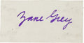 "Autographs:Authors, Zane Grey Card Signed. 3.25"" x 1.75"". Signed in purple ink. Adhesive ghosting of the recto from mounting remnants on the ver..."