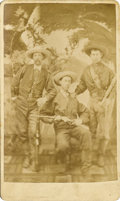 Photography:Studio Portraits, CIVILIAN SCOUTS OR ARMY PACKERS WITH SPENCERS CARBINES. Ca. 1870's. Three scouts sitting in studio all appear to be wearing ... (Total: 1 Item)
