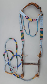 A NORTHERN PLAINS BEADED LEATHER BRIDLE AND REINS c. 1900