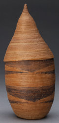Tribal Art, Tutsi, (Rwanda). Lidded basket. Plant fiber, natural dye. Height: 8½ inches. ...