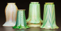 Art Glass:Other , FOUR QUEZAL AND STEUBEN IRIDESCENT GLASS LAMP SHADES. Circa 1900.Enameled Quezal. Ht. 6-1/2 in. (largest). ... (Total: 4Items)