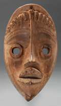 Paintings, Dan (Liberia). Ble-Gle Mask. First quarter 20th century. Note: Square holes around perimeter. Height: 9 inches. ...