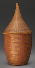 Tribal Art, Tutsi, (Rwanda). Lidded basket. Plant fiber, natural dye. Height:11 ½ inches. ...