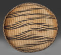 Tribal Art, Tutsi, (Rwanda). Presentation tray. Plant fiber, natural dye.Diameter: 6 ¾ inches. ...