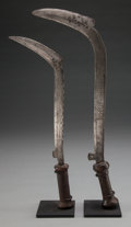 Tribal Art, Nsakara, (Democratic Republic of Congo). Two knives. First half20th century. Forged iron, wood handles, custom bases. Heigh...(Total: 2 Items)