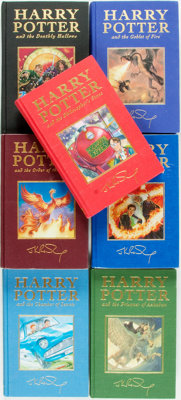 [Featured Lot] J.K. Rowling. The Complete Deluxe Edition Harry Potter Series. London: Bloomsbury, [1999-2007]. First