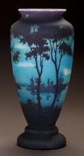 Glass, DAUM OVERLAY GLASS LANDSCAPE VASE. Circa 1900. Cameo DAUM, NANCY, with the cross of Lorraine. Ht. 13-3/4 in.. ...