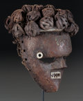 Tribal Art, Salampasu, (Democratic Republic of Congo). Mask . First half 20thcentury. Wood raffia, copper pinned with wooden pegs, a pr...