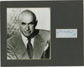 "Movie/TV Memorabilia:Autographs and Signed Items, Samuel Goldwyn Signature Cut with Photo. A 3.5"" x 1.5"" autograph cut by Goldwyn in black ink, matted along with a b&w 8"" x 1... (Total: 1 Item)"