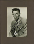 "Movie/TV Memorabilia:Autographs and Signed Items, Michael Rennie Signed Photo. A b&w 8"" x 10"" photo of Michael Rennie, inscribed and signed by him in black felt tip. Matted t... (Total: 1 Item)"