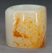A CHINESE JADE ARCHER'S RING, Qing dynasty 1-1/4 inches high (3.2 cm)