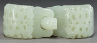A CHINESE JADE BUCKLE, Qing dynasty 4-1/4 inches long (10.8 cm)