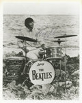 Music Memorabilia:Autographs and Signed Items, Ringo Starr Signed Photograph. A great mid-'60s photo of Ringo on arocky coast, playing (or posing with) his Ludwig drum se... (Total:1 Item)