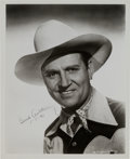 Movie/TV Memorabilia:Autographs and Signed Items, A Gene Autry Signed Black and White Photograph, 1943....