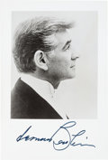 "Autographs:Celebrities, Leonard Bernstein Photograph Signed. Measuring 3.75"" x 5.5"", theprolific composer and pianist is seen in profile. He has pl..."