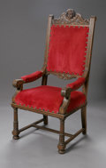 Furniture : American, AN AMERICAN VICTORIAN CARVED OAK HALL CHAIR. Late NineteenthCentury. The carved oak arm chair with finely carved cupid at...
