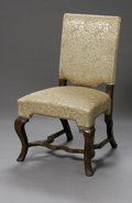 Furniture: French, THE FRENCH SIDE CHAIR. Early Eighteenth Century. The upholsteredside chair, on carved cabriole legs, carved stretcher, me...