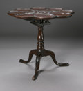 Furniture , A GEORGIAN TILT TOP TABLE. American, Late Nineteenth Century. The mahogany tilt-top table of lobed form, stylized carved f... (Total: 1 Item Item)
