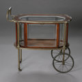 Furniture , A GLASS TEA CARRIAGE. Late Nineteenth Century. The mahogany tea carriage (or vitrine) with eight beveled panel on large sp... (Total: 1 Item Item)