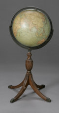 Furniture , A VINTAGE WORLD GLOBE. Early Twentieth Century. The world globe on a reeded base with brass claw feet. 39in. high. Herit... (Total: 1 Item Item)