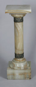 Marble:American, AN ONYX PEDESTAL. Twentieth Century. The green veined onyx pedestalwith columnar shaft on squared plinth, gilt metal deco...