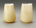 Art Glass:Other , TWO ART GLASS VASES. Maker unknown. The matching buttercup vaseswith bulbous bubble release bodies, cased in cream, ruffl...(Total: 2 Items)