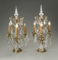 A PAIR OF GIRANDOLES American, Circa 1920  The pair of gilt metal and moulded glass girandoles, each with three tiers of...
