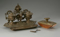 Bronze:American, A BRONZE INKWELL AND STAMP ROLLER. Maker unknown. The bronze chairinkwell with two wells and stamp together with a br...(Total: 2 Items)