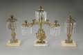 Decorative Arts, American:Lamps & Lighting, A THREE PIECE BRASS CANDLE SET. Maker unknown. The three piececandlestick set with hanging crystal prisms on intricately ...(Total: 3 Items)