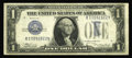 Error Notes:Inverted Third Printings, Fr. 1606 $1 1934 Silver Certificate. Inverted Third Printing.Fine-Very Fine. The blue third printing is inverted on this $1...