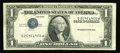 Error Notes:Inverted Third Printings, Fr. 1614 $1 1935E Silver Certificate. Fine+.. This examplesustained much circulation before someone realized theimportance...