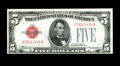 Error Notes:Skewed Reverse Printing, Fr. 1527 $5 1928B Legal Tender Note. Choice About Uncirculated..This skewed reverse shows a portion of the note from the sh...