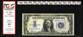 Small Size:Silver Certificates, Fr. 1606* $1 1934 Silver Certificate. PCGS Apparent Choice New 63.. This scarce Star Note has deep embossing and pleasing ma...