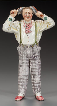 AUSTRIAN POTTERY FIGURE OF A VAIN GENTLEMAN, circa 1900 Marks: BB 4887 (effaced marks) 10-3/4 inches