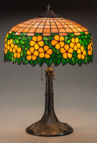 AMERICAN LEADED GLASS AND BRONZED METAL TABLE LAMP, circa 1910 24 inches high x 16 inches diameter (61.0 x 40.6 cm